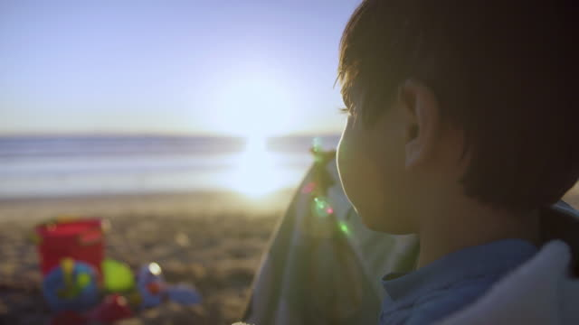 toddler eating granola bar as the sun sets - protein bar stock videos & royalty-free footage