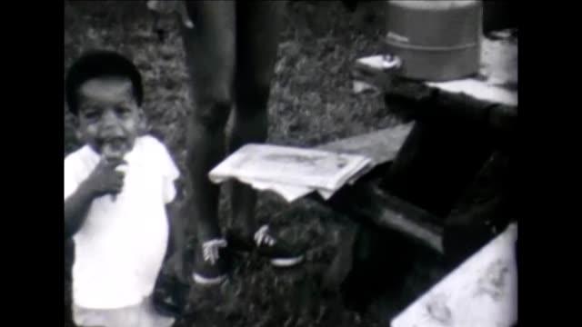 1955 toddler enjoying picnic - bloomers stock videos & royalty-free footage