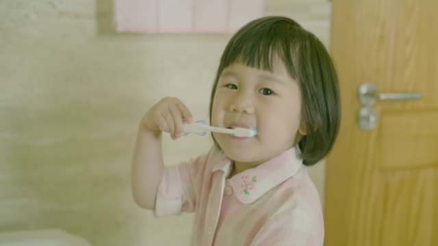 toddler girl brushing teeth by herself - east asian ethnicity stock videos & royalty-free footage
