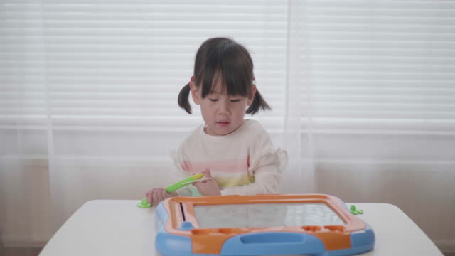 toddler  girl drawing on white board - pencil stock videos & royalty-free footage