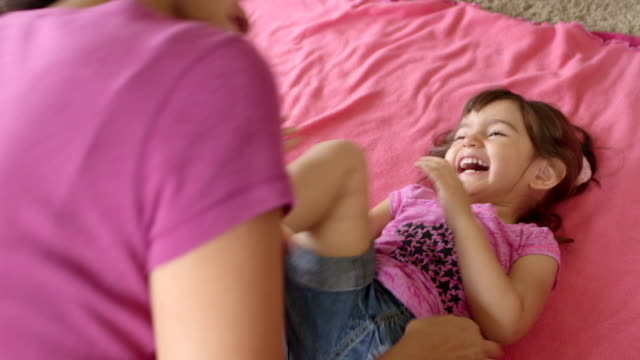 toddler girl gets tickled by mom - tickling stock videos & royalty-free footage