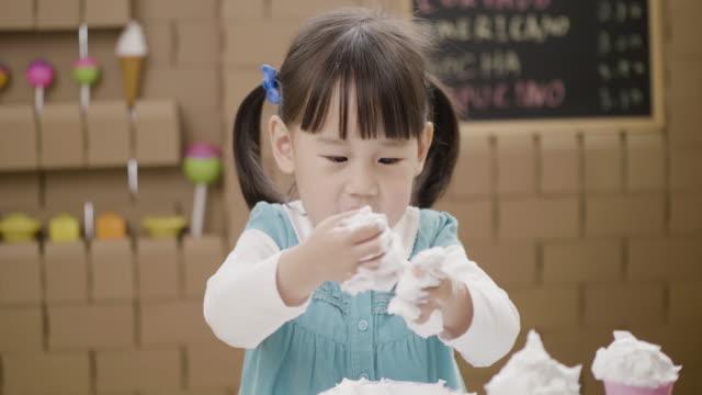 toddler girl hand playing fake ice cream - preschool stock videos & royalty-free footage