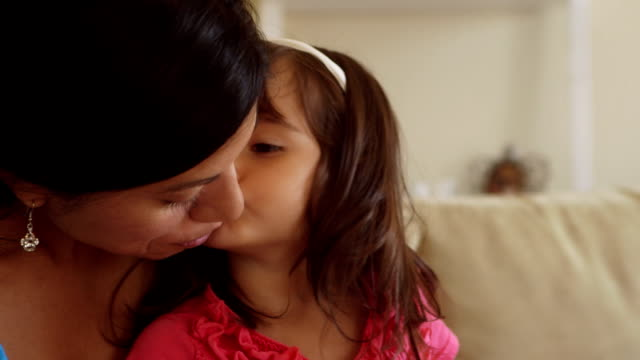 toddler girl kisses mother on cheek while on lap - toddler stock videos & royalty-free footage