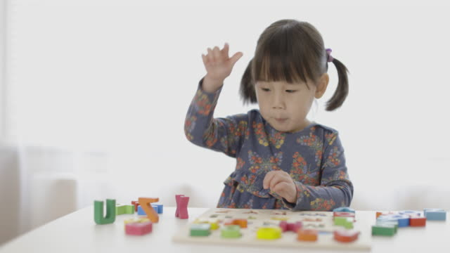 toddler girl learning alphabet blocks  for homeschooling - the alphabet stock videos & royalty-free footage