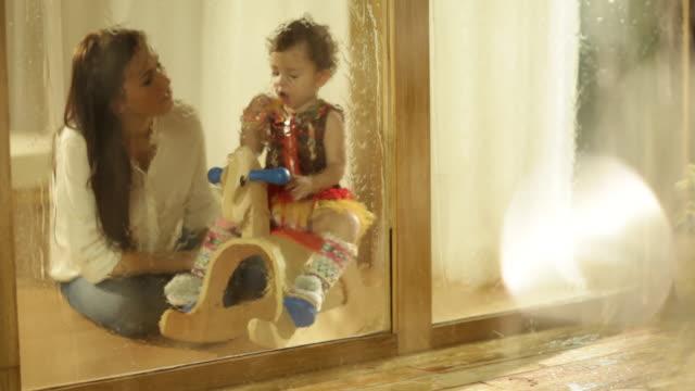 Toddler girl on rocking horse.