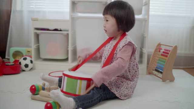 toddler girl play drum at home - toddler stock videos & royalty-free footage