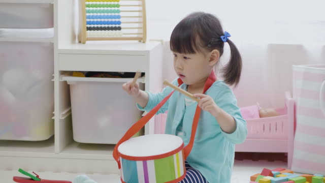toddler girl play drum at home - drum percussion instrument stock videos & royalty-free footage