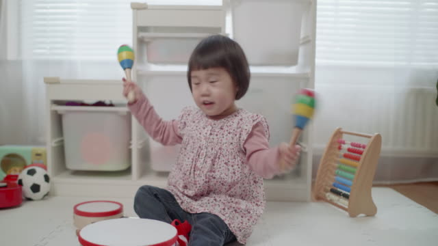 toddler girl play  maracas at home - maraca stock videos & royalty-free footage