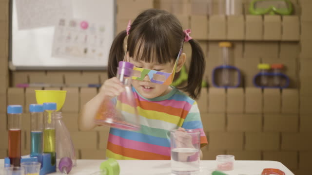 toddler girl play science experiment color mixing - nursery school child stock videos & royalty-free footage