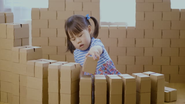 toddler girl play with carton blocks building a house - only girls stock videos & royalty-free footage