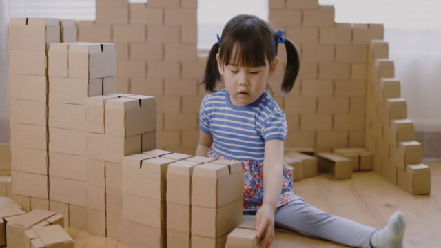 toddler girl play with carton blocks building a house - maynooth stock videos & royalty-free footage