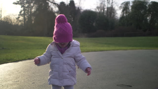 toddler girl playing hide and seek in winter countryside park - hide and seek stock videos & royalty-free footage