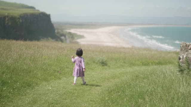 toddler girl playing in summer countryside,northern ireland - 4k resolution stock videos & royalty-free footage