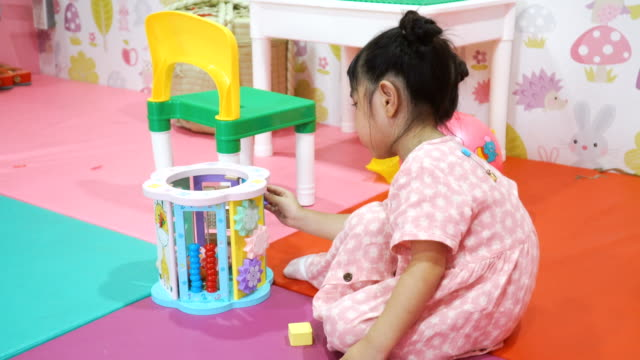 toddler girl playing puzzle in toy room - nursery bedroom stock videos & royalty-free footage
