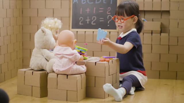 toddler girl pretend play as teacher role at home - trade union stock videos & royalty-free footage