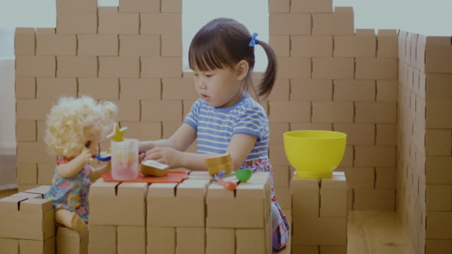 toddler girl pretend play baby care role in carton house - maynooth stock videos & royalty-free footage