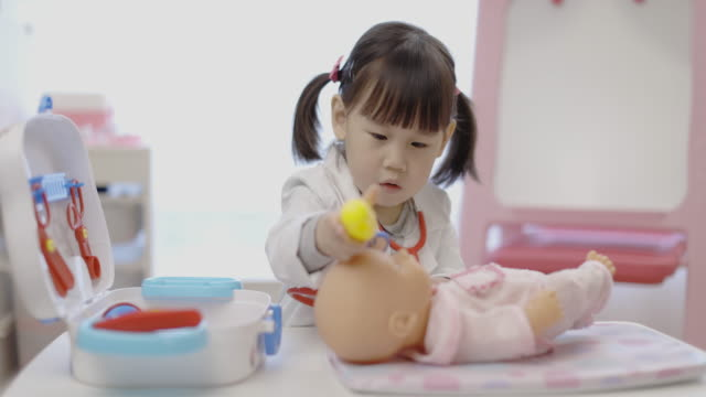 toddler girl pretend playing doctor looking after patient - girls stock videos & royalty-free footage