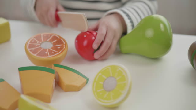 toddler girl pretend playing food preparing toy at home - simple living stock videos & royalty-free footage