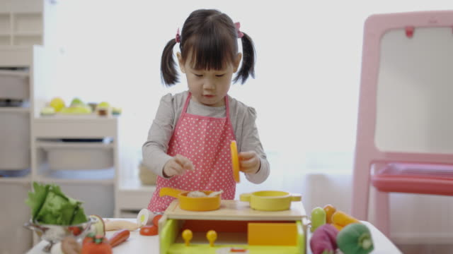 toddler girl pretend playing food preparing - toy stock videos & royalty-free footage
