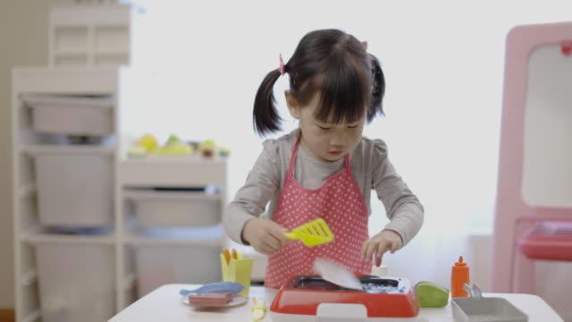 toddler girl pretend playing food preparing - kitchen stock videos & royalty-free footage