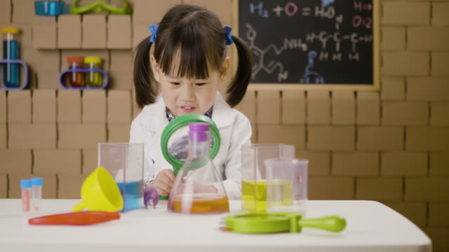toddler girl pretend playing scientific research game at home - stone object stock videos & royalty-free footage