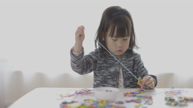 toddler girl string wooden bead crafts for homeschooling - choker stock videos & royalty-free footage