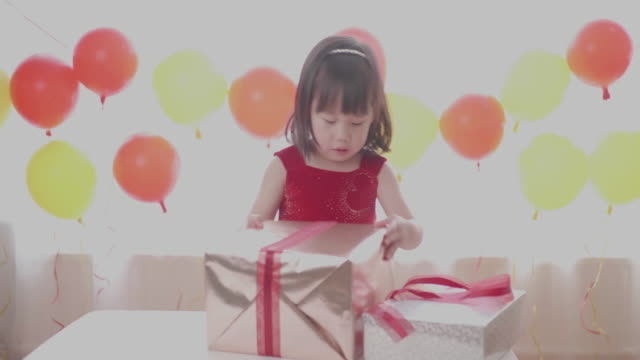 toddler girl unpacking her birthday gift box - birthday gift stock videos & royalty-free footage