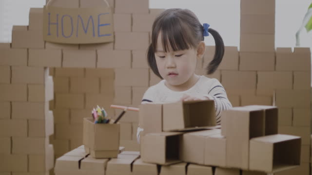 toddler girl using carton blocks making animal crafts for homeschooling - maynooth stock videos & royalty-free footage