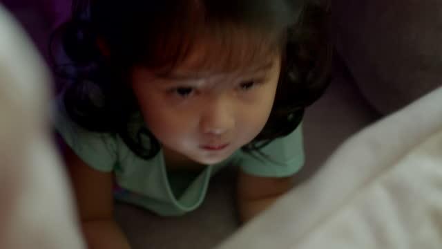 toddler girl watching cartoon on mobile phone. digital native. addict - digital native stock videos & royalty-free footage