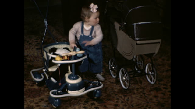 1945 Toddler girl with stroller, teddy bear and walker - Home Movie