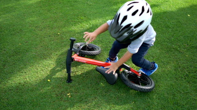 toddler grab a balance bike and ride. - balance stock videos & royalty-free footage
