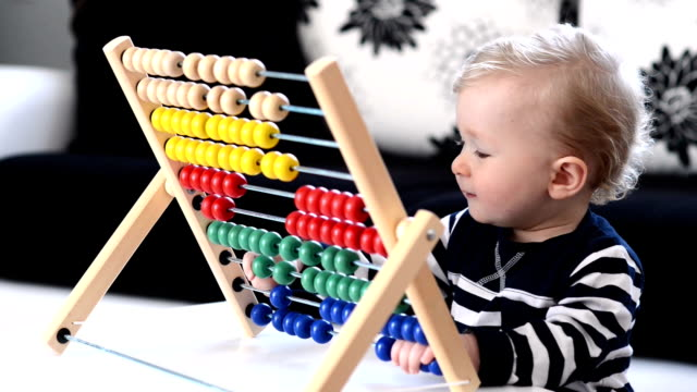 toddler having fun with abacus - nursery school building stock videos and b-roll footage