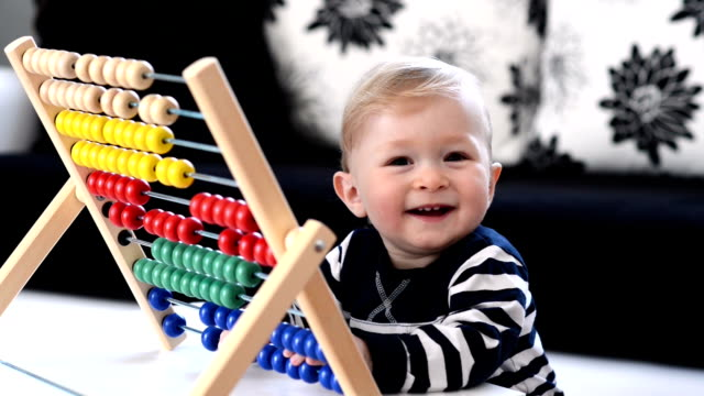 FAST MOTION: Toddler having fun with abacus