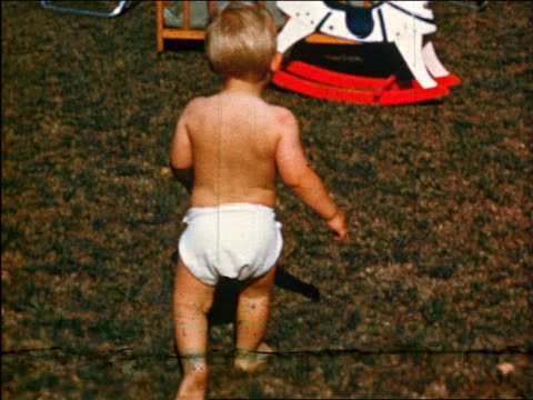 1950 rear view toddler in diapers walking outdoors / industrial - nappy stock videos and b-roll footage