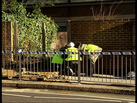 toddler killed by collapsed wall: general views of wall / engineers at scene; england: london: belsize park: ext various of structural engineers... - teddy boy stock videos & royalty-free footage