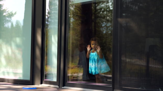 ms toddler looking out window of vacation home - family with two children stock videos & royalty-free footage