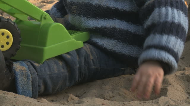 toddler on playground with a toy - sand pit stock videos and b-roll footage