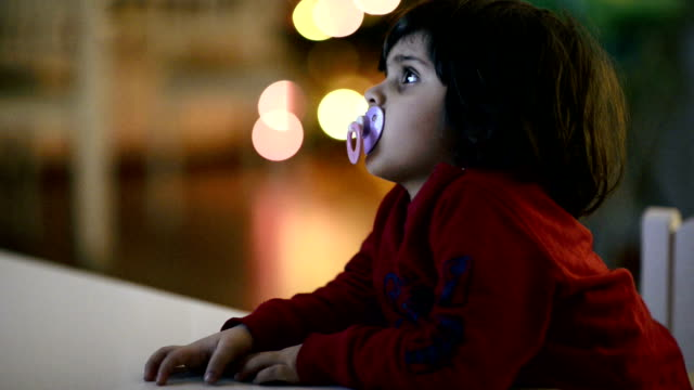 toddler on tv, watching focused - atrophy stock videos & royalty-free footage