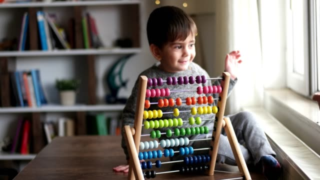 toddler playing with abacus - subtraction stock videos & royalty-free footage