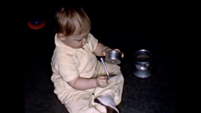 1955 Toddler Playing With Coffee Percolator and Blocks