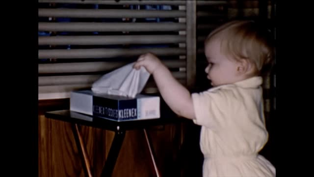 1955 Toddler Playing With Kleenex Tissues
