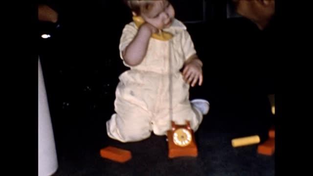 stockvideo's en b-roll-footage met 1955 toddler playing with mother and nanny - huishoudelijke dienstverlening