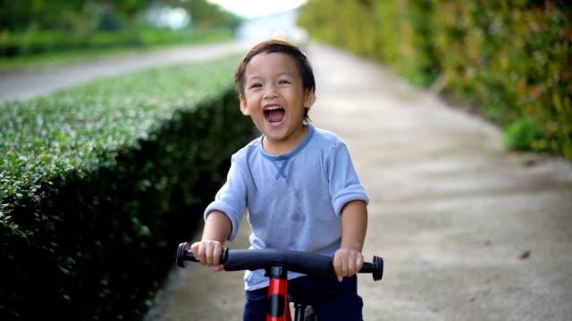 toddler riding balance bike. - outdoors stock videos & royalty-free footage