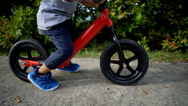 toddler riding balance bike. - balance stock videos & royalty-free footage