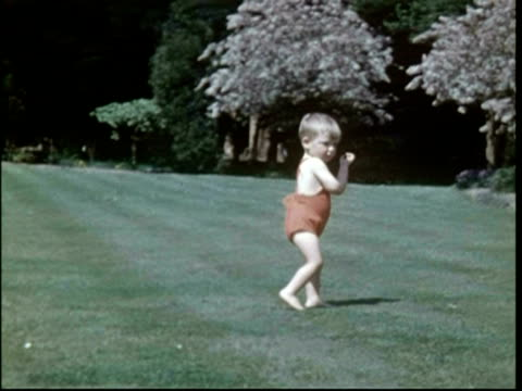 Toddler running around, plus mother, 1951