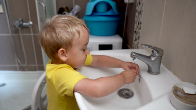 toddler splashing his face - bathroom sink stock videos & royalty-free footage