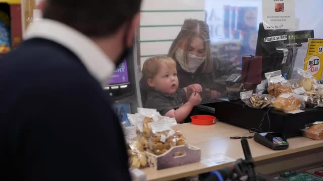 toddler stars in christmas advert for family shop; scotland: scottish borders: ayton: ayton mini market: int sequence reporter into local shop and... - scotland stock videos & royalty-free footage
