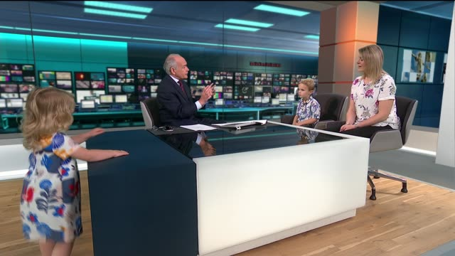 toddler takes over itv news studio during live interview; england: london: gir: int lucy wronka live studio interview on milk allergies with children... - オフビート点の映像素材/bロール
