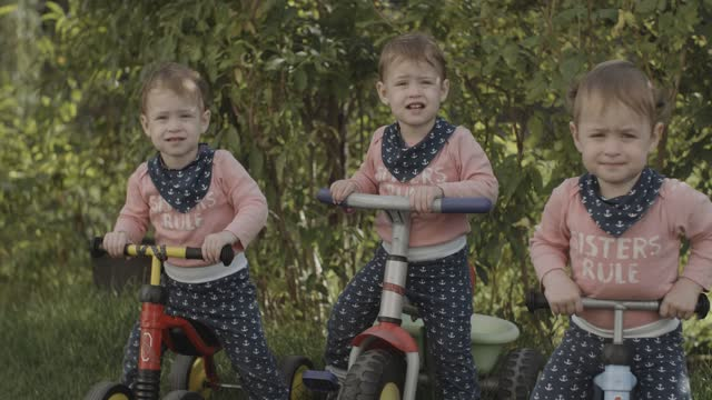 toddler triplets - tricycle stock videos & royalty-free footage