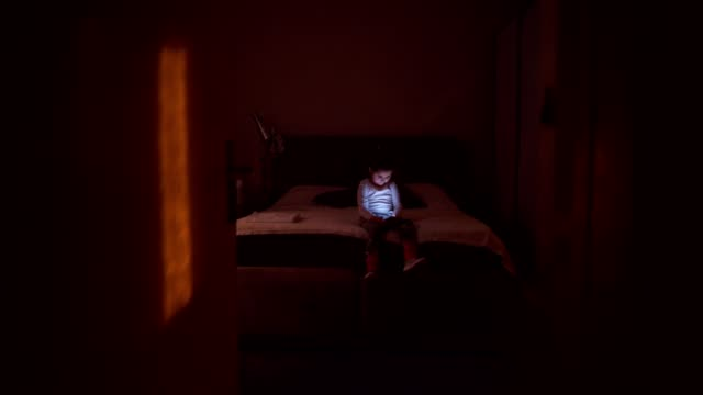toddler using phone alone at night - solitude stock videos & royalty-free footage